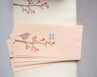 Stationery winterberry and robin redbreast