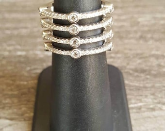sterling silver and cubic zirconia 4 row band ring. SIZE 6