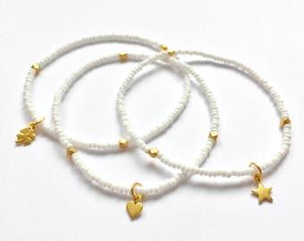 Delicate golden charm bracelets