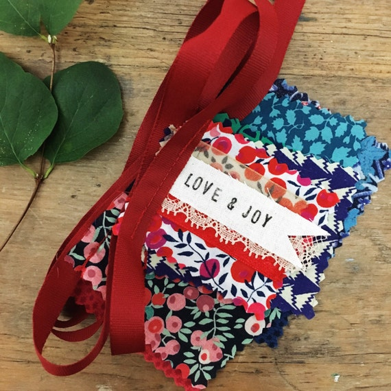 Festive Liberty fabric garland with secret message 'LOVE & JOY' - cosy Christmas colours - Christmas Liberty bunting - red and green