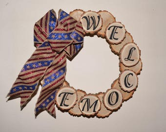 Wood Slice Welcome Wreath with Stars and Stripes Ribbon, Rustic wood log slice wreath with patriotic ribbon