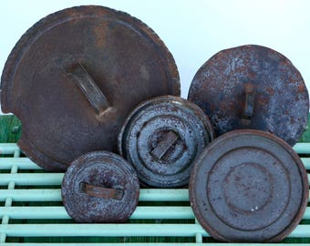 Salvaged Italian rusty metal lids