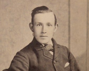 Carte-de-visite, antique.   Featuring a seated young man.  Israel Todd, Otley, (W. Yorks).  c 1890's.