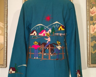 1940s 50s Mexican Embroidered Wool Souvenir Jacket by Lopez -- Vibrant Colors against Blue Background