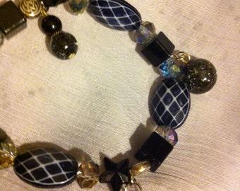 Black beaded Celtic knot bracelet.