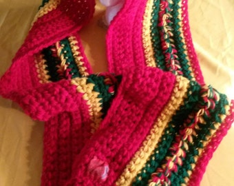 Based in NYC. The Power of the Red, Green and Gold. The Perfect Rasta Colors Styled in this Blazing Handmade Crocheted Infinity Scarf