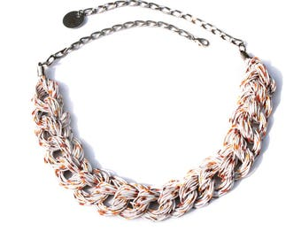 Upcycled jewelry. White and beige necklace made from recycled electric cables TAIPEI