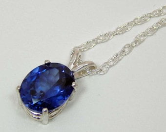 Blue Topaz Necklace. Blue Topaz in Sterling Silver Prong Setting. Facet Blue Topaz 10mm x 8mm