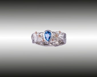Silver and gold royal ring with blue topaz