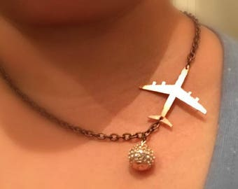 sidepiece airplane necklace with illusion ball