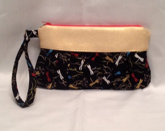 Wristlet/Clutch purse in a lovely dragonfly print with pleated front, zipper closure and detatchable hand strap