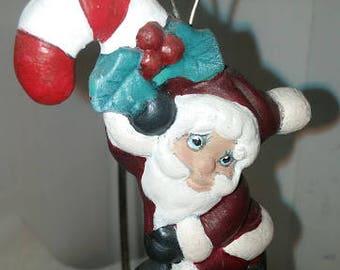 Santa on a Candy Cane Ornament