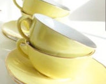 The Luneville Keller & Guerin set of 5 cups and saucers; in perfect condition; solid yellow with gold trim; from the 1940-50's.