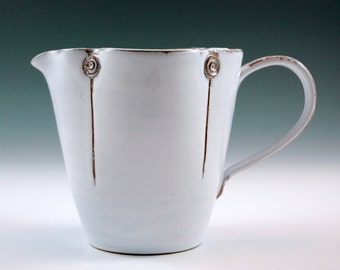 White pitcher,medium size with straight form.
