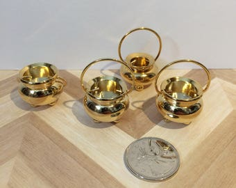 Heavy brass pots and vases/urns