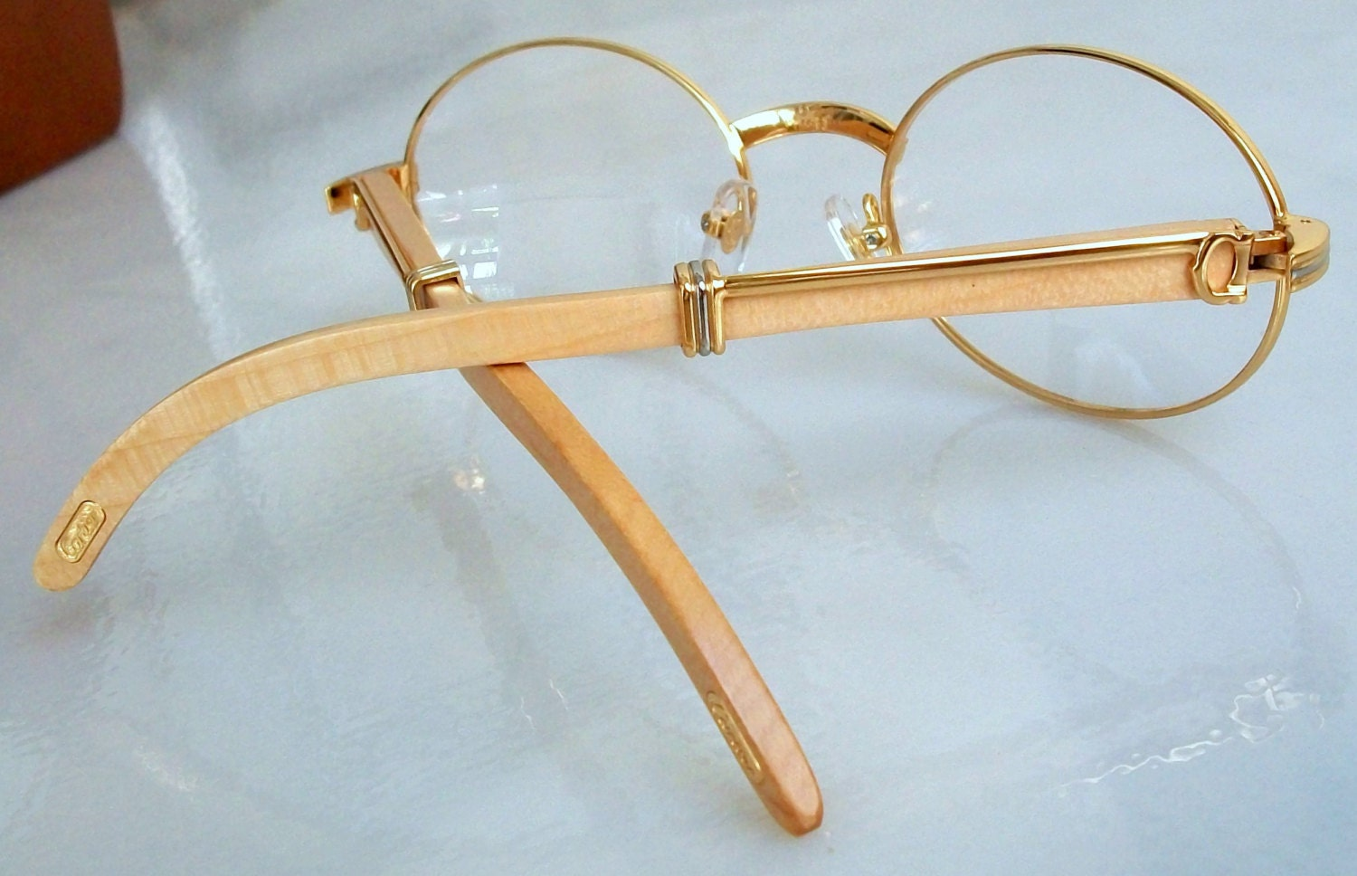 Gold And Silver Eyeglass Frames : Eyeglasses Gold Oval Frame Light Wood Temples Silver details.