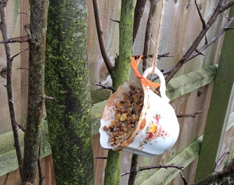 Vintage Tea Cup bird feeder - Hand filled with fat ball bird food - All ready to hang in your garden