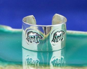 Handmade Navajo Sterling Silver cuff style earring with kokopelli or bear design