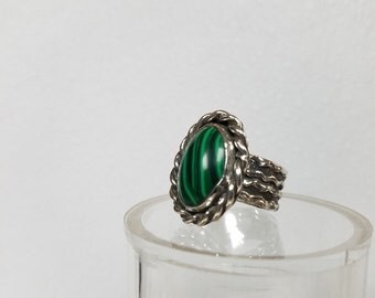 This ring is a Malachite size 7 .  It has a wide band on it