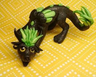Green and black dragon