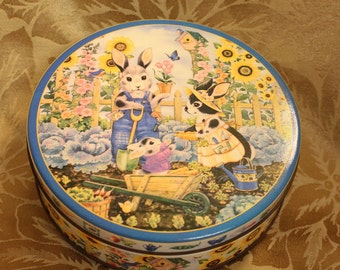 Mr and Mrs Rabbit and Baby Bunny Tin Gardening Tin Sunflowers