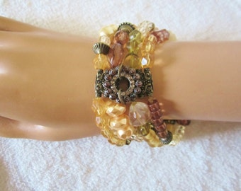 Four Strand Stretch Bracelet- in delightful autumn  colors. A combination of acrylic beads in various sizes, colors & shapes. Vintage piece!