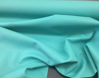 Luxurious manta ray Design Upholstery Fabric Vinyl aqua. Sold by the yard