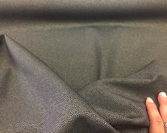 Luxurious manta ray Design Upholstery Fabric Vinyl gold Black. Sold by the yard