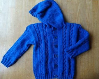 Hand Knitted childs wool jacket 24 ins Chest 2 to 3 yrs. Blue cable with Hoodie & 6 buttons.