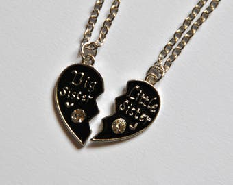 "Two heart necklaces broken, sister, older sister and younger sister. With stras and enamelled in black. ""Big sister"" and ""Little Sister"""