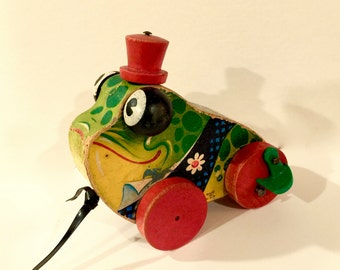 Vintage Frog Pull Toy, Fisher Price Grand Pa Frog, Wood Pull Push Toy, Lithograph Design with flowers, Red Wood Top Hat, Google Eyes, 1950s