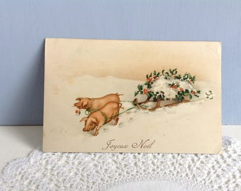 Vintage French Christmas Postcard 'Joyeux Noel' with a Pair of Pigs Pulling a Sleigh August Rokl