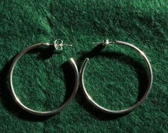 Hand made solid silver hoop earrings