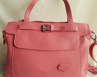 Pink calfskin leather lined with pockets adjustable shoulder strap and handles, shoulder