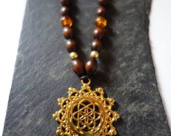 Seed of life gold necklace, amber
