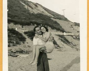Original Vintage Snapshot Found Photo Vernacular Photo Man Holding Woman in his Arms at Beach Happy Couple 1950s Fashion -B936
