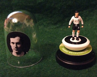 Franz Beckenbauer (Germany) - Hand-painted Subbuteo figure housed in plastic dome.