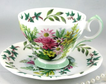 Queen Anne Teacup & Saucer, Royal Academy Series, Floral Pattern, Bone English China made in 1970s.