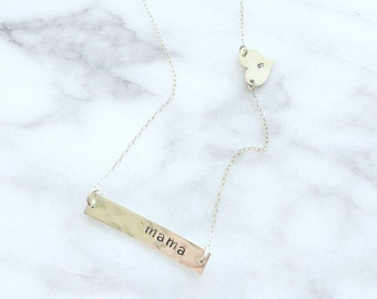 Bar with heart necklace