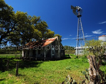 Photograph of windmill and old house
