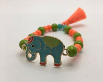 Turquoise Elephant Charm with Neon Orange & Spring Green beaded flexible bracelet Neon Electric Orange Tassel.