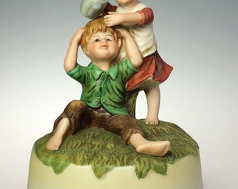 Vintage Porcelain Music Box Little Girl Teasing Boy Raindrop Keep Falling Head