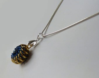 Whirly Bird as a pendant in yellow and blue