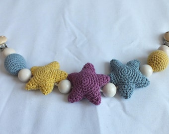 Pram toy featuring 3 crocheted stars and 8 wooden balls (2 with crocheted covers) - wooden clips to attach.