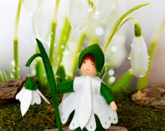 Flower child snowdrop handmade out of wool felt and wool. Waldorf inspired for on the nature table.
