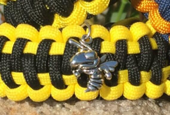 Georgia Tech Yellow Jackets Paracord Bracelet, antigue silver metal logo charm, whistle buckle