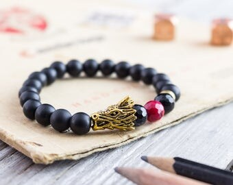 8mm - Matte black onyx beaded gold Dragon head stretchy bracelet with a faceted red coral bead,  mens bracelet, womens bracelet