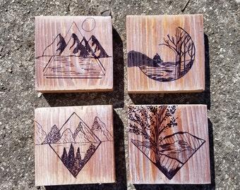 landscape drawings on wood blocks