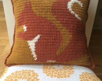 Crochet cushion cover with squirrel design
