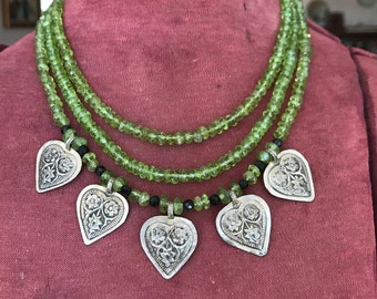 Sterling silver, peridot, onyx, mother of pearl three strand necklace
